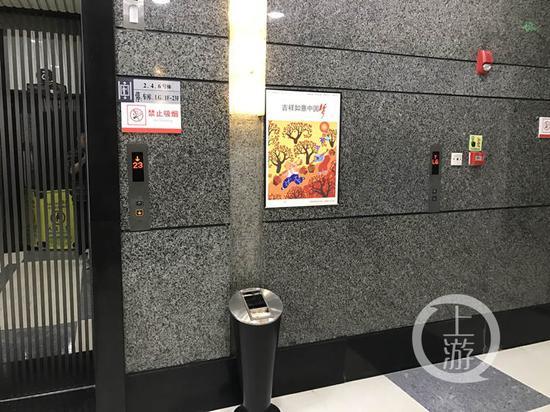 重庆一栋写字楼现奇葩电梯 只见按钮不见门
